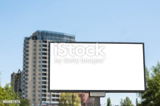 istock Blank advertisement board on the street of the city. 969981874