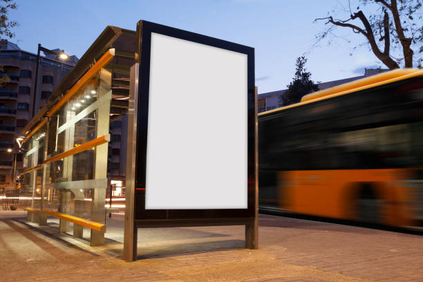 Blank advertisement in a bus stop Blank advertisement in a bus stop, with blurred bus sheltering stock pictures, royalty-free photos & images