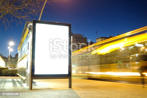 istock Blank advertisement mock up in a bus stop 910633436