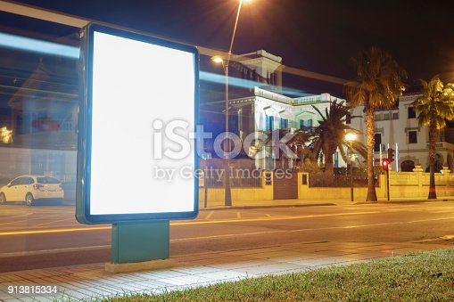 1036904778 istock photo Blank advertisement mock up in a bus stop 913815334