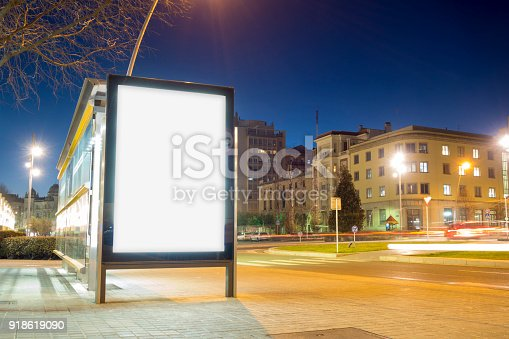 1036904778 istock photo Blank advertisement mock up in a bus stop 918619090