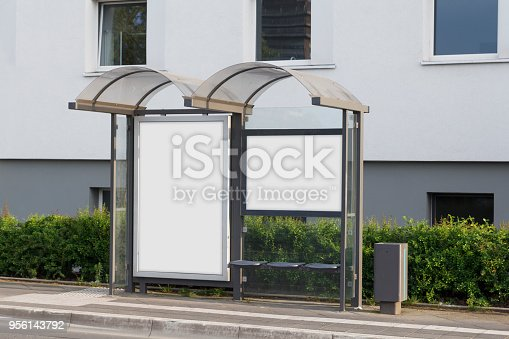 1036904778 istock photo Blank advertisement mock up in a bus stop 956143792