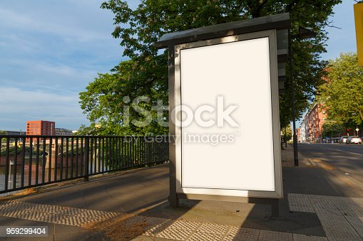 1036904778 istock photo Blank advertisement mock up in a bus stop 959299404