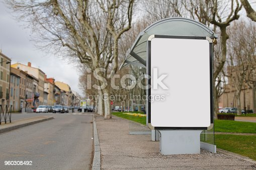 1036904778 istock photo Blank advertisement mock up in a bus stop 960308492