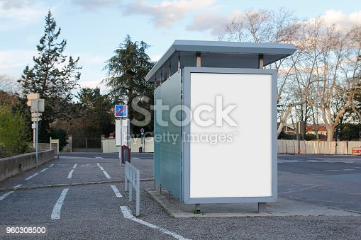1036904778 istock photo Blank advertisement mock up in a bus stop 960308500
