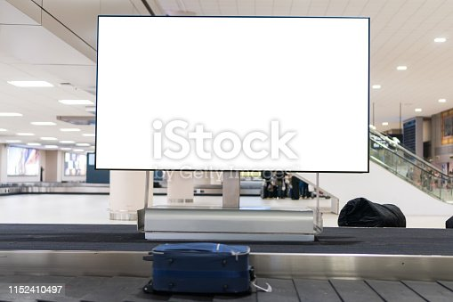 istock Blank advertising billboard at conveyor belt luggage in airportat airport. Copy space for cutomer text information advertise about tourism transport business etc. 1152410497