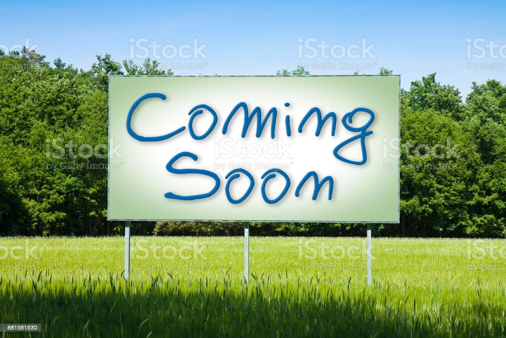 Blank advertising billboard in a rural scene with 'Coming Soon' text written on it stock photo