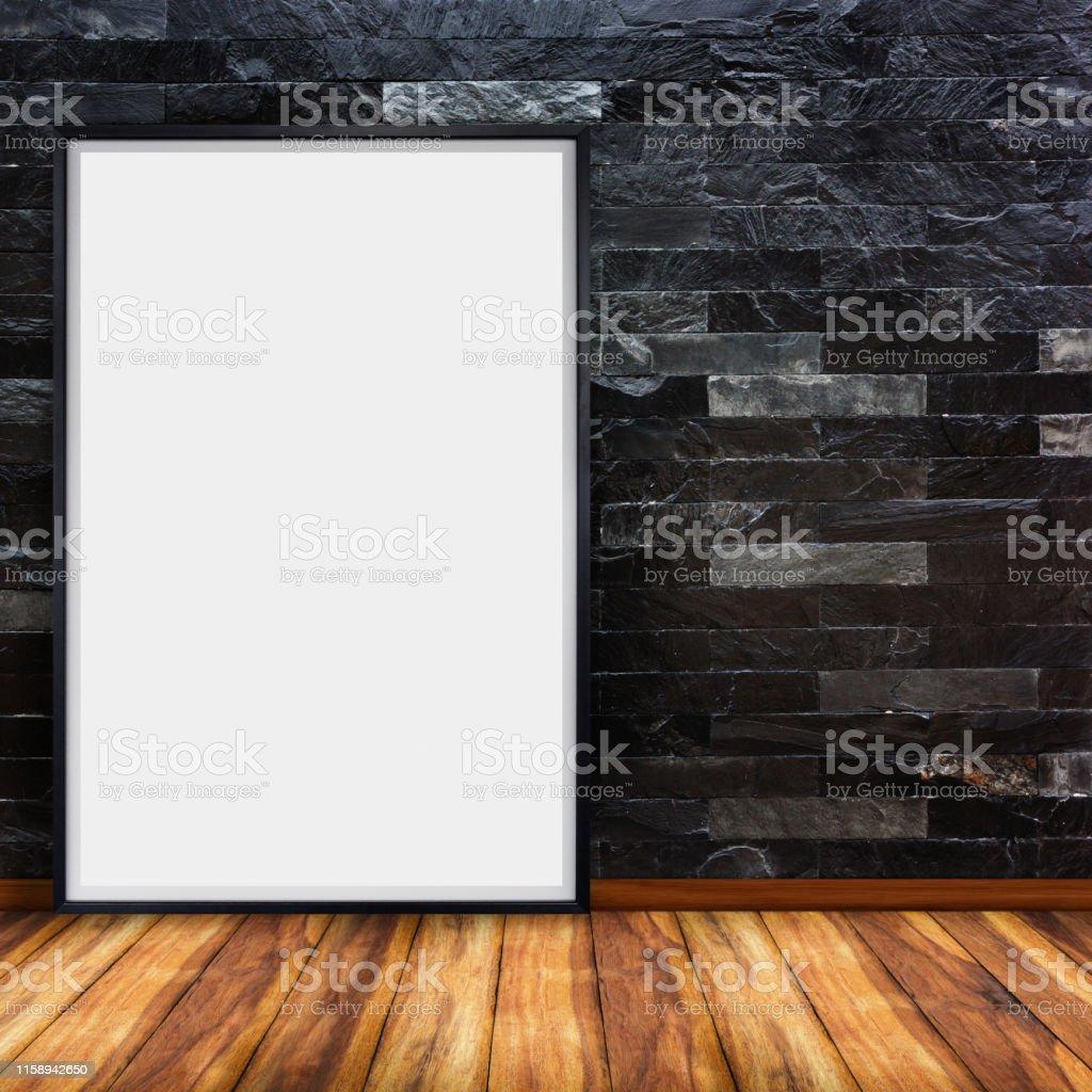 Blank advertising billboard on black stone brick wall with wood floor...