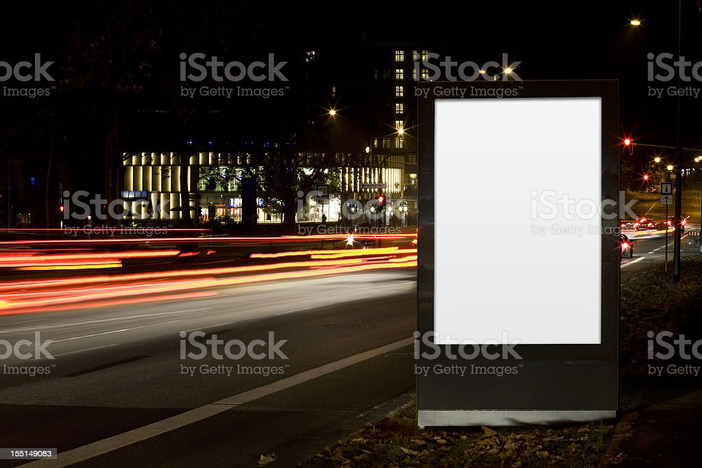 Blank advertising billboard on city street at night royalty-free stock photo