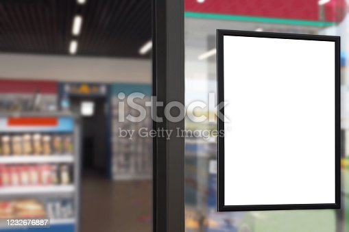 istock Blank advertising billboard placard (Clipping Path) in the market window with blurred merket background 1232676887