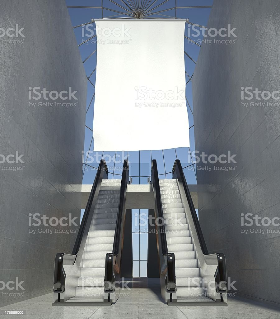 Blank advertising flag and escalator in interior royalty-free stock photo