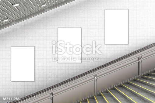 istock Blank advertising poster on underground escalator wall 887411286