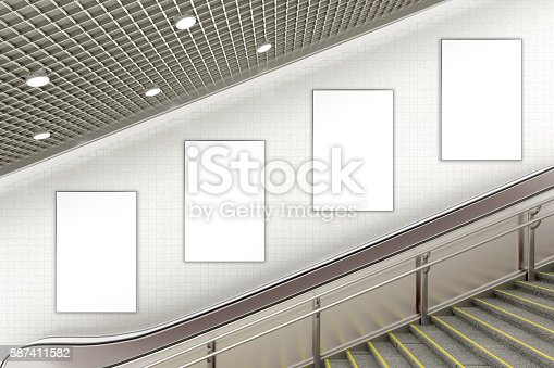 istock Blank advertising poster on underground escalator wall 887411582