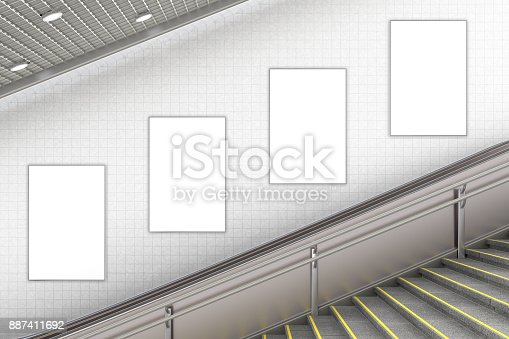 istock Blank advertising poster on underground escalator wall 887411692