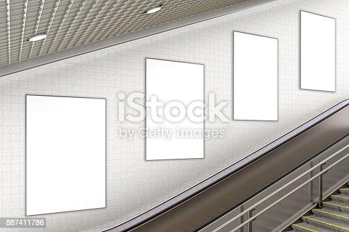 istock Blank advertising poster on underground escalator wall 887411786