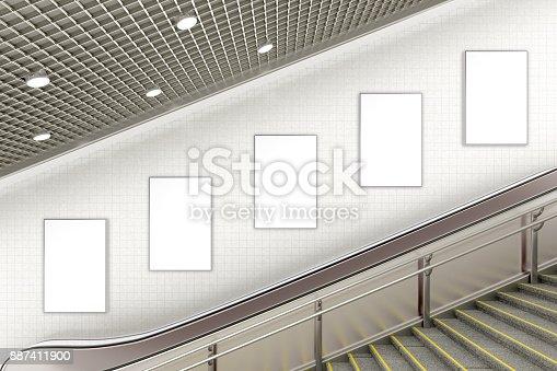 istock Blank advertising poster on underground escalator wall 887411900