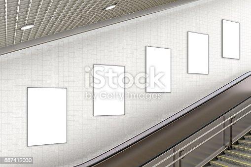 istock Blank advertising poster on underground escalator wall 887412030