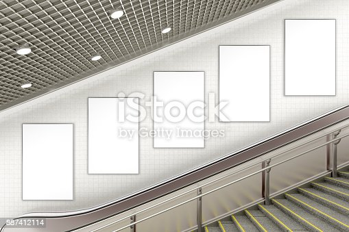 istock Blank advertising poster on underground escalator wall 887412114