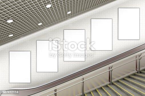 istock Blank advertising poster on underground escalator wall 887412114