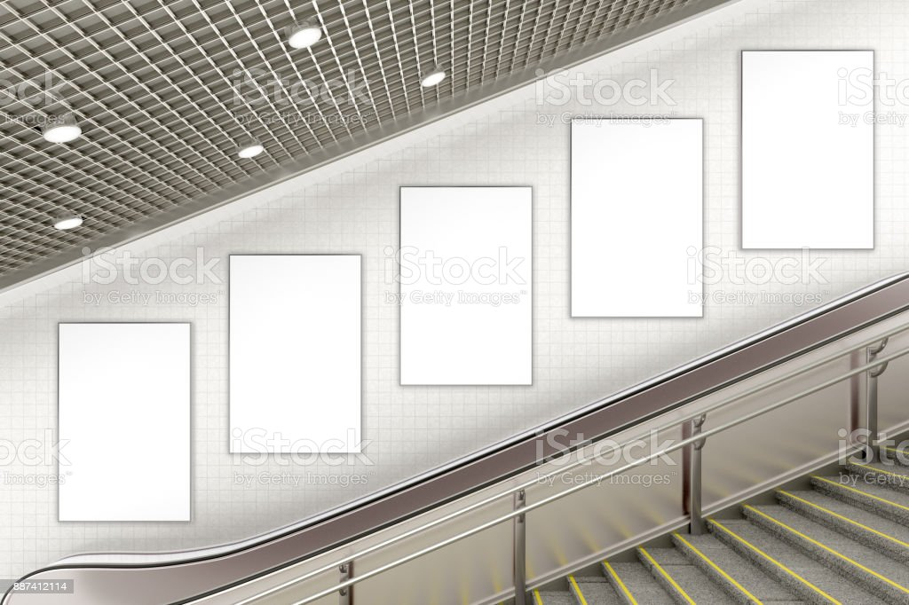 Blank advertising poster on underground escalator wall stock photo