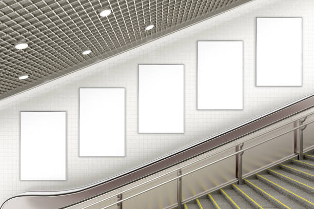 blank advertising poster on underground escalator wall - poster stock pictures, royalty-free photos & images