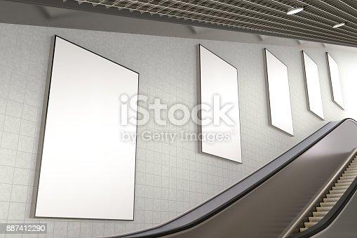 istock Blank advertising poster on underground escalator wall 887412290