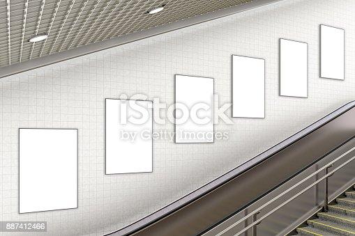istock Blank advertising poster on underground escalator wall 887412466