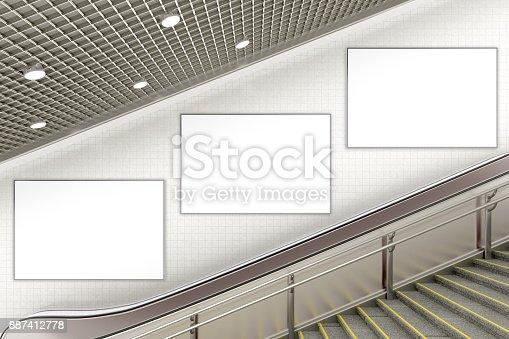 istock Blank advertising poster on underground escalator wall 887412778