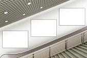 Three blank advertising posters on underground escalator wall. 3d illustration