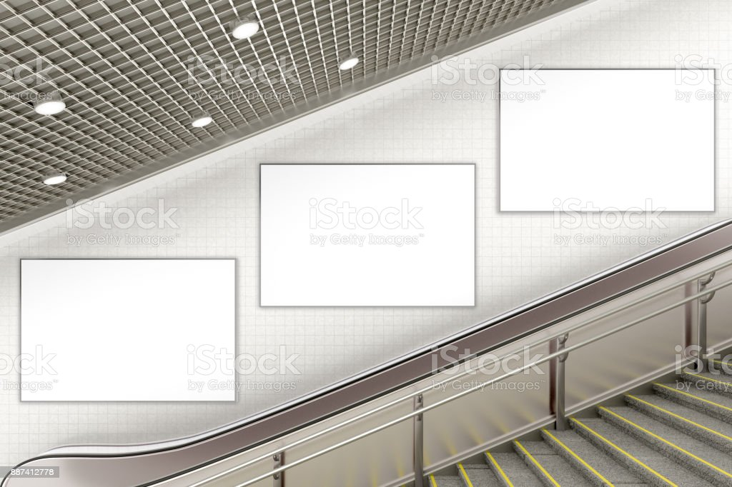 Blank advertising poster on underground escalator wall stock photo