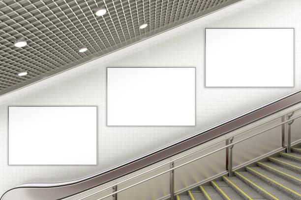 blank advertising poster on underground escalator wall - dworzec zdjęcia i obrazy z banku zdjęć