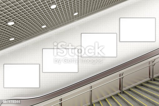 istock Blank advertising poster on underground escalator wall 887419344