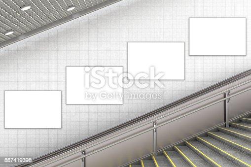 istock Blank advertising poster on underground escalator wall 887419398