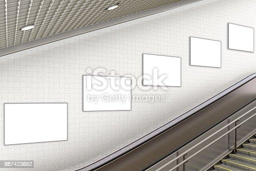 istock Blank advertising poster on underground escalator wall 887423652