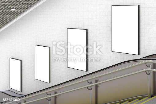 istock Blank advertising poster on underground escalator wall 887424360