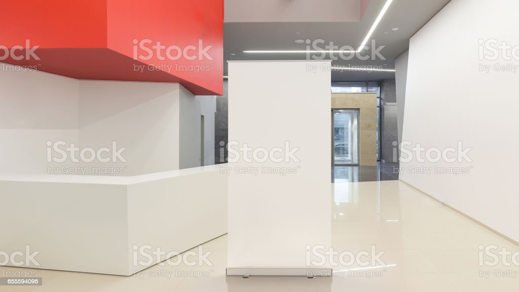 Blank advertising roll-up stand stock photo