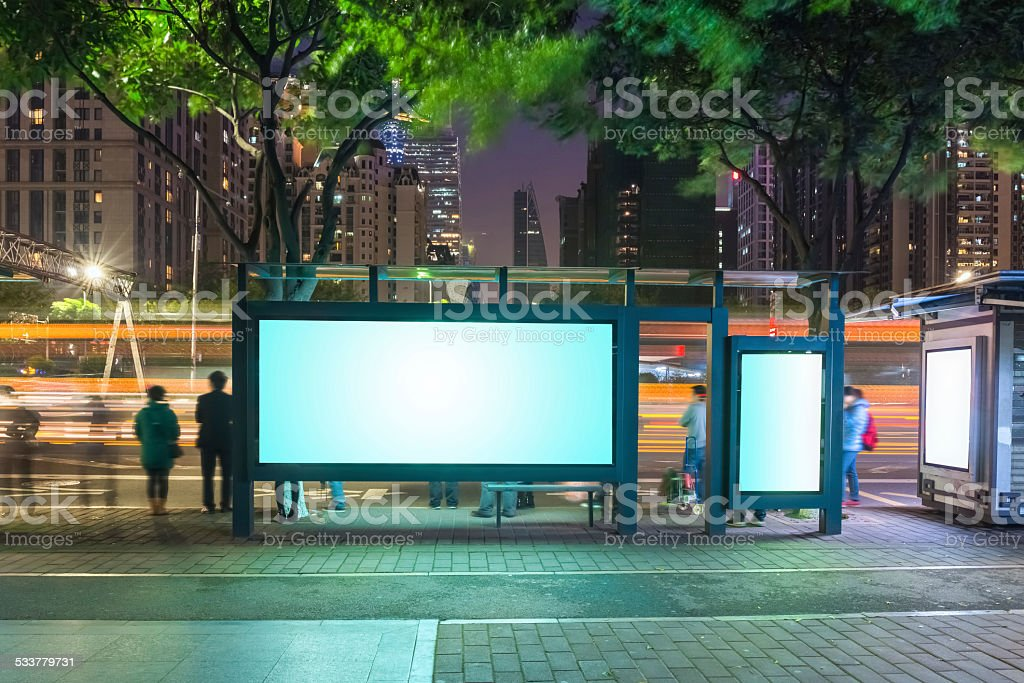 blank advertising screen on the bus station at night