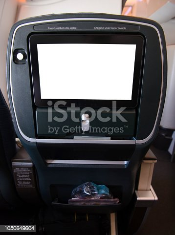 Blank aircraft monitor in passenger seat.