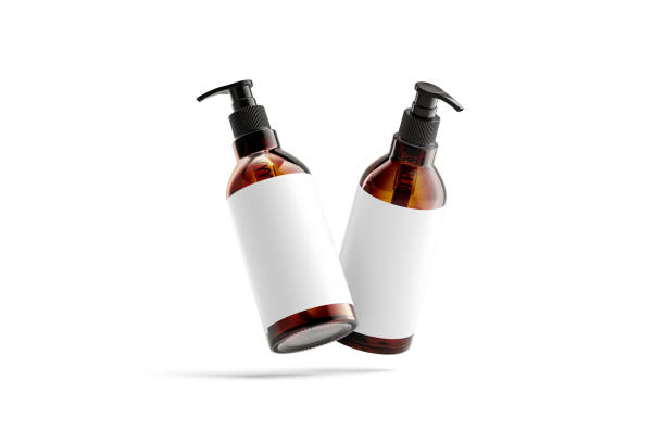 Blank amber glass pump bottle with white mockup, no gravity stock photo