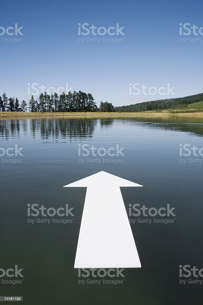 Blank arrow on water with trees royalty-free stock photo