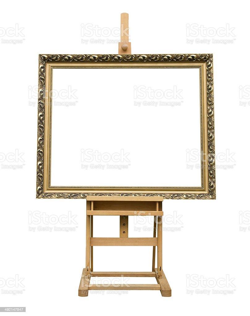 Blank art frame on wooden easel. stock photo