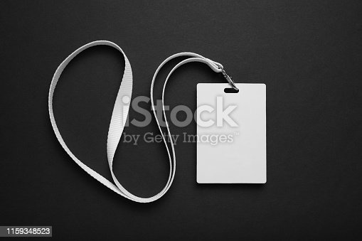 istock Blank badge mockup. Plain empty name tag mock up hanging on neck with string 1159348523