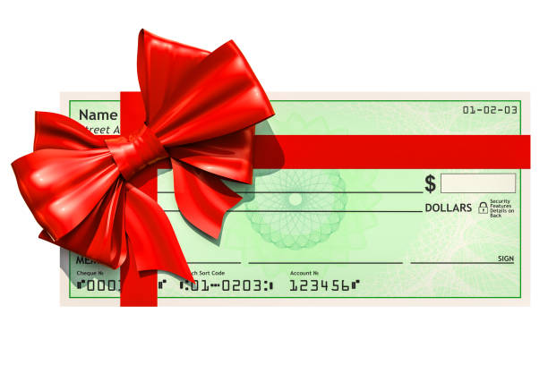 Blank bank check with red bow, 3D rendering isolated on white background stock photo