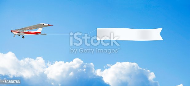 flying plane and blank banner. marketing background...