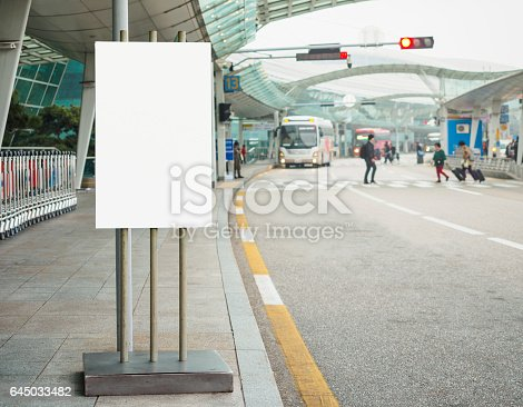 841502736 istock photo Blank Banner stand Building Airport shuttle bus service 645033482