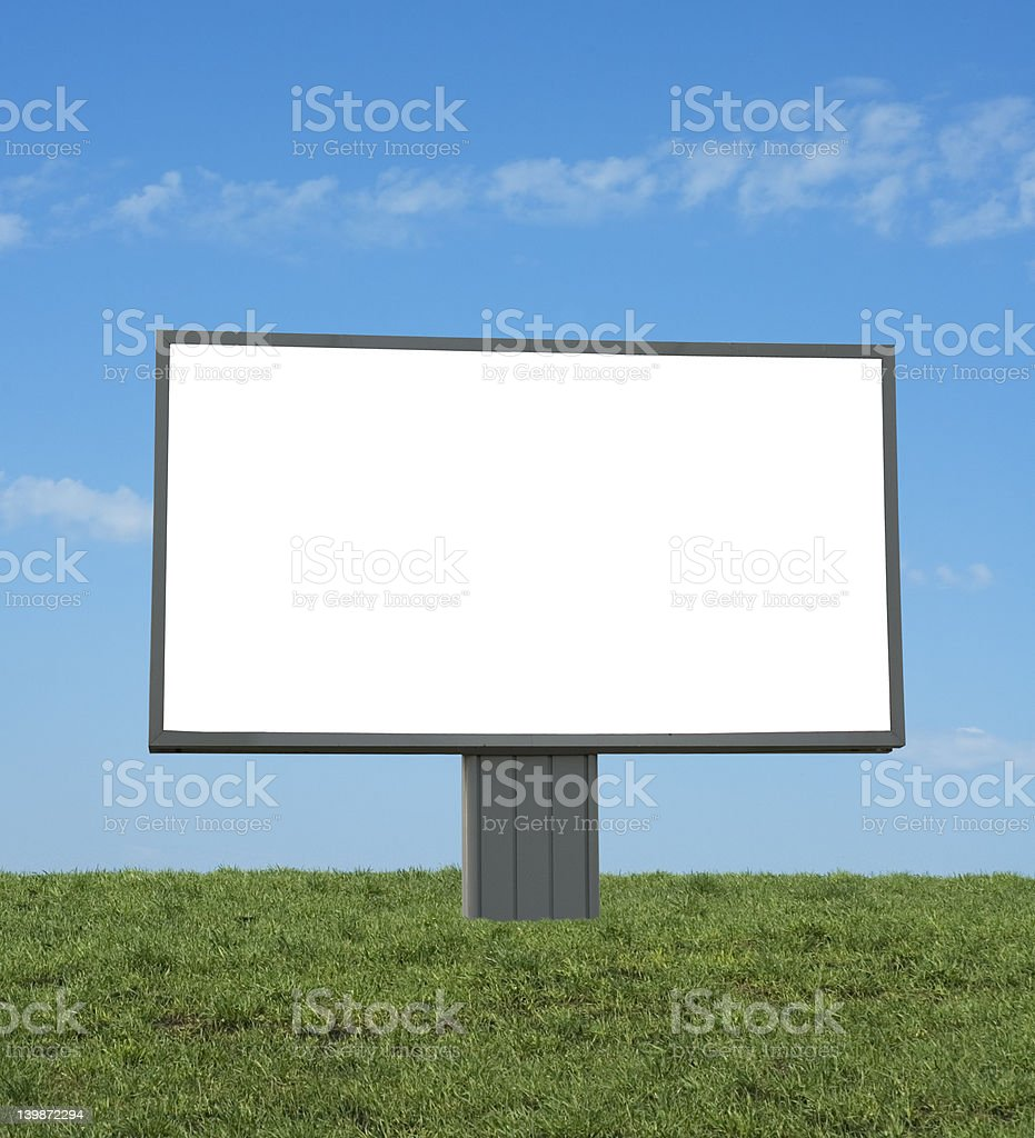 blank bilboard in a green field, add your text royalty-free stock photo
