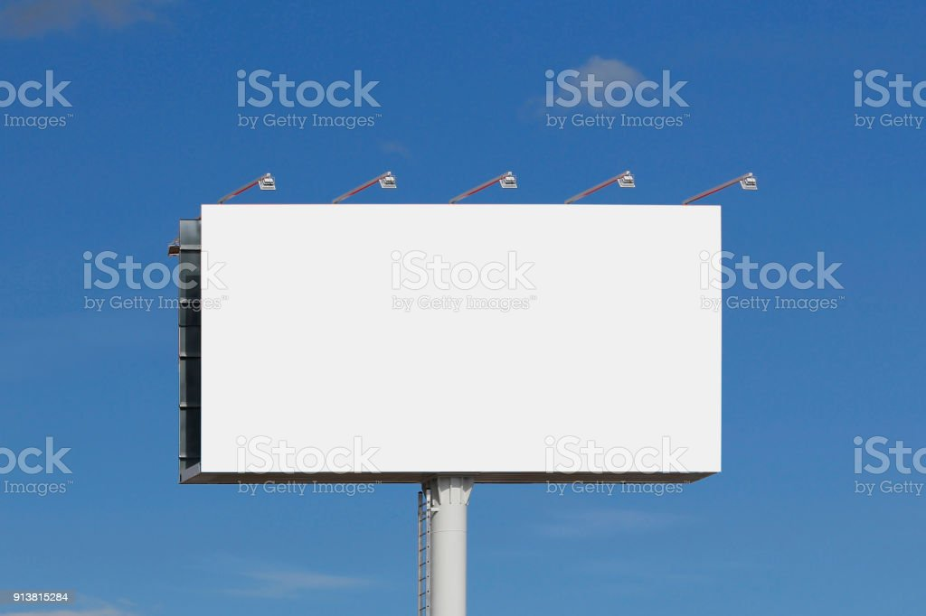 Blank billboard against blue sky stock photo