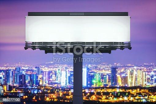 158172107 istock photo Blank Billboard Against Cityscape At Night 685277100