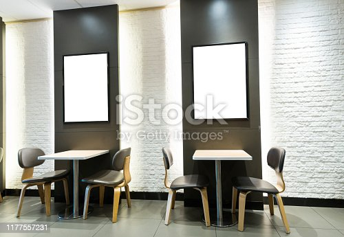 Blank billboard and tables in restaurant.