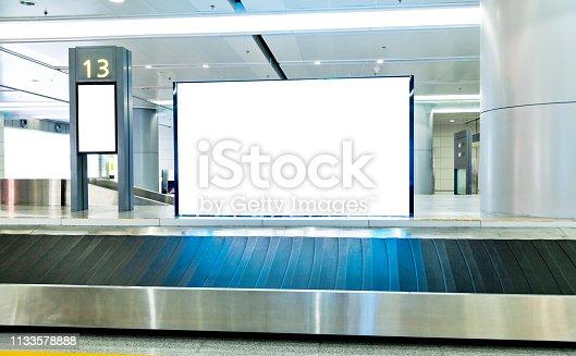 Blank billboard at baggage claim.